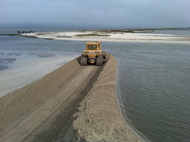 A Crew From The Department Of Natural Resources And Environmental Control Works To Rebuild Dune North Primehook Beach Following Hurricane Irene