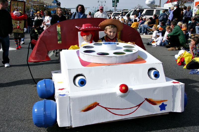 jessie the cowgirl and woody the cowboy ride in the sea witch halloween costume parade in their retro fisher price mobile phone by dave koster