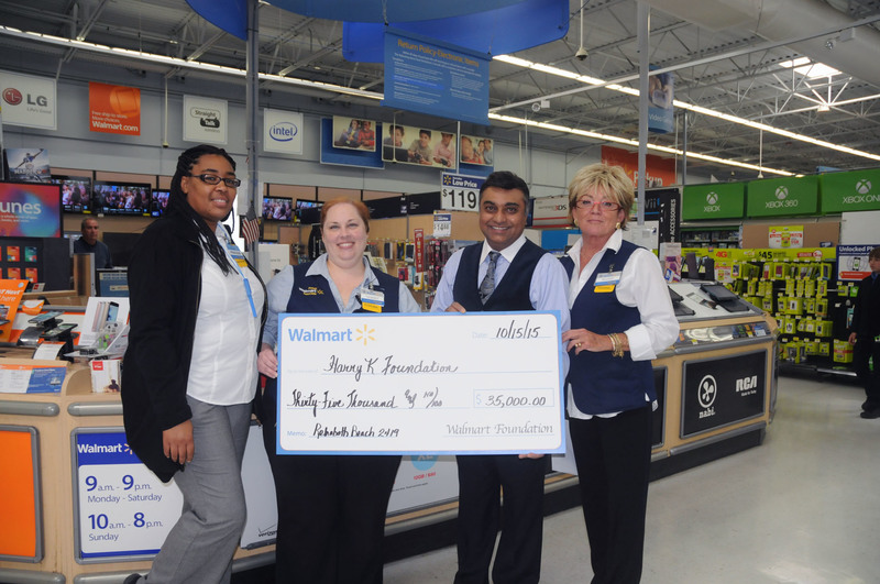 Assistant Manager Tammy Schulze Store Harry Keswani From The K Foundation And Lonnie Brown Personnel BY STEVEN BILLUPS