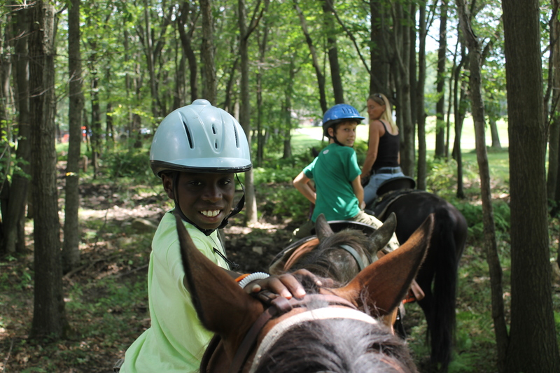 Khalilou Of The Bronx Spent A Day Horseback Riding With His Fresh Air Fund Host Family Sydnors Shown Are L R Khaililou Evan Sydnor And Janet