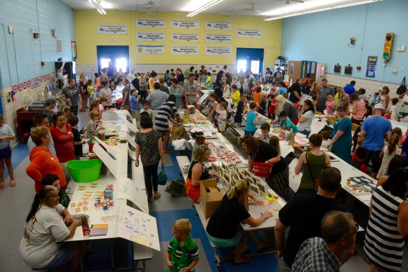 elementary school cafeteria. The Shields Elementary School Cafeteria Is Filled With Second Graders Marketing Their Wares To Parents And Fellow Classmates During Annual E