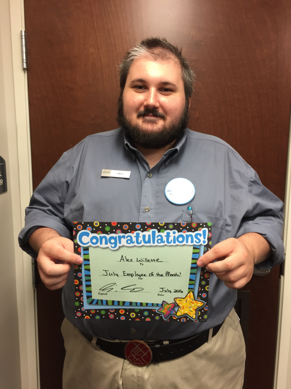 Georgetown Microtel Front Desk Ociate Alex Willette Accepts His Award Of Employee The Month For Wyndham Hotels And Resorts Corporation