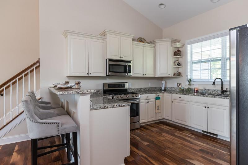 Feature loaded former model home close to beach 339 900 for Lilly s craft kitchen