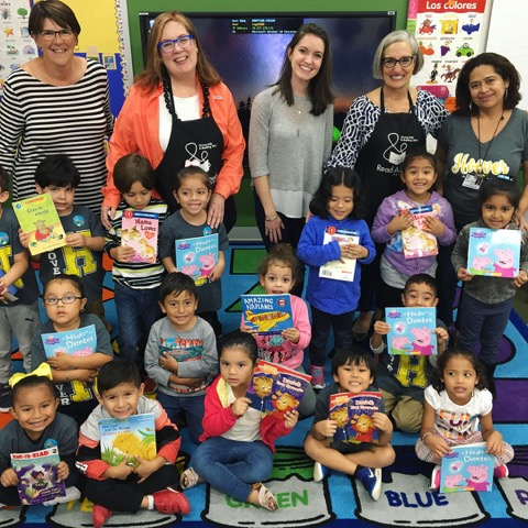 Local volunteers read to youngest hurricane victims