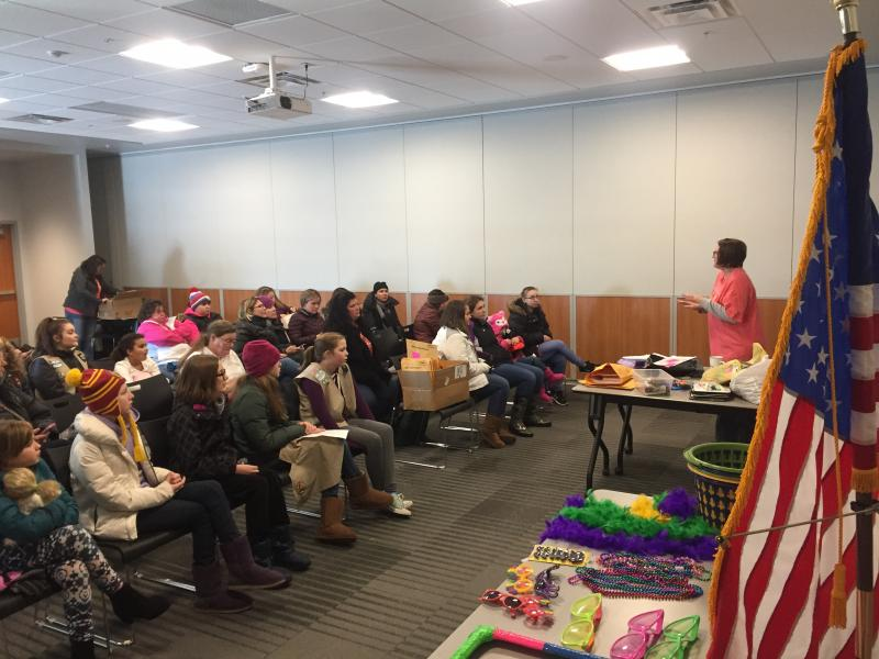 Kathleen Esposito leads a presentation for troop leaders and cookie captains the older Girl Scouts who mentor cookie rookies