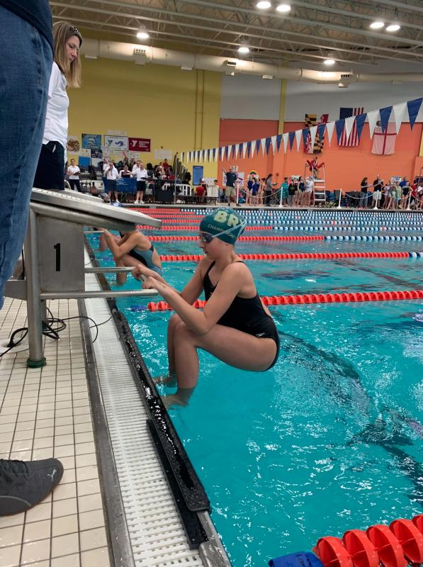 Woodstock co-op swim team starts season with new coach