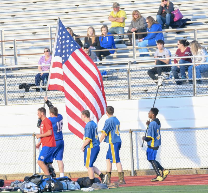 3895d739379 Sussex Central athletes run the American flag down the track during the  early moments of the varsity game. DAVE FREDERICK PHOTOS