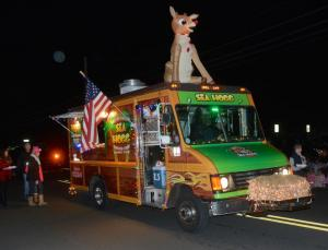 The Sea Hogg food truck is decorated for the season and cooking food samples as it motors along the parade route. RON MACARTHUR PHOTO