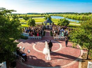 Outdoor wedding ceremony with golf course views, seating up to 200 guests.