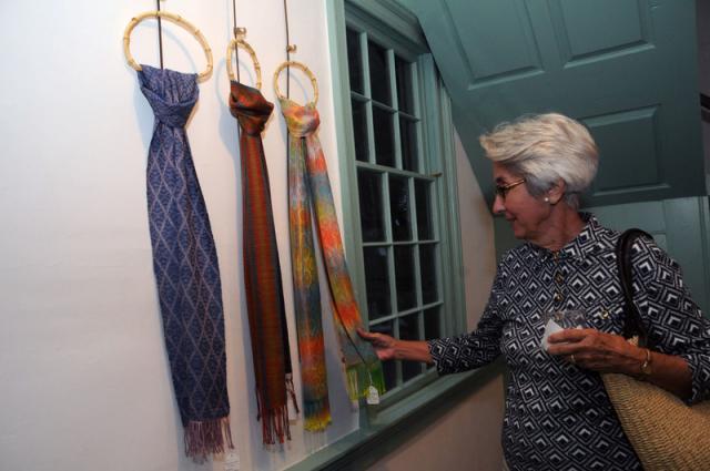 Connie McGood Admires The Hand Woven Scarves By Deborah Idema In Homestead Gallerys Member Showcase Wearable Art BY STEVEN BILLUPS